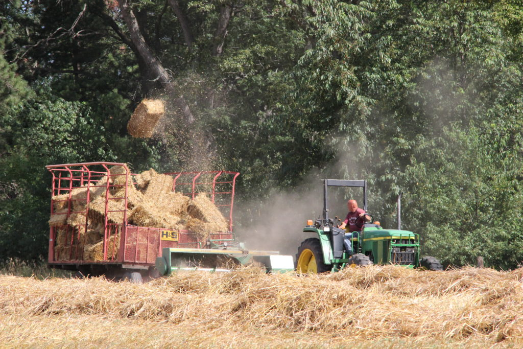 Tractor with baler